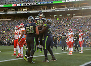 Aug 25, 2017; Seattle, WA, USA; Seattle Seahawks running back Tre Madden (38) celebrates with center Justin Britt (68) and offensive guard Germain Ifedi (76) ater scoring on a 2-yard touchdown reception in the second quarter against the Kansas City Chiefs during a NFL football game at CenturyLink Field.