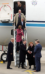 Colombia's President Juan Manuel Santos and his wife Maria Clemencia de Santos are welcomed to George Best Belfast City Airport by Northern Ireland Secretary of State James Brokenshire, during a state visit.