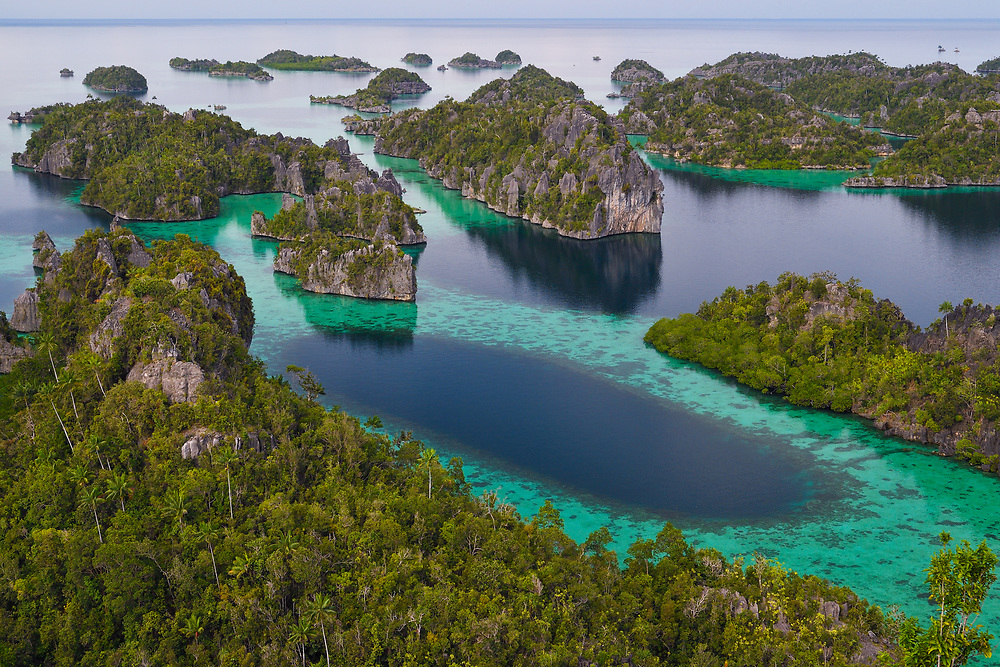 Karst landscapes in Misool archipelago, Raja Ampat, Western Papua, from the book PAPUA - AMONG BIRDS OF PARADISE AND MANTA RAYS