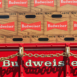 Lancaster, PA, USA - August 4, 2016: Close up of Budweiser Beer on red horse-drawn wagon.