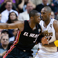 10 March 2011: Los Angeles Lakers shooting guard Kobe Bryant (24) defends on Miami Heat shooting guard Dwyane Wade (3) during the Miami Heat 94-88 victory over the Los Angeles Lakers at the AmericanAirlines Arena, Miami, Florida, USA.