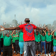 NBA All Star LeBron James throws powder into the air with kids at an event at the Boys & Girls Club of Central Florida on Saturday, Feb. 25, 2012 in Orlando, Florida. The LeBron James Family Foundation and Sprite donated sporting equipment and introduced a new baseball diamond, renovated play area and a picnic area.  (AP Photo/Alex Menendez)