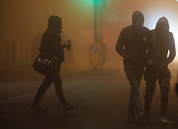 © Licensed to London News Pictures. 27/11/2020. <br /> New Eltham, UK. Commuters walking in the fog to New Eltham train station, London. Freezing foggy weather conditions this Friday morning across large parts of the UK. Photo credit:Grant Falvey/LNP