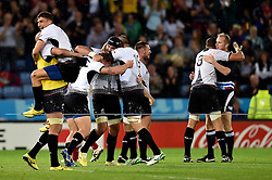 Referee Wayne Barnes is hugged by Mihai Macovei as Romania celebrate their first ever Rugby World Cup win - Mandatory byline: Patrick Khachfe/JMP - 07966 386802 - 06/10/2015 - RUGBY UNION - Leicester City Stadium - Leicester, England - Canada v Romania - Rugby World Cup 2015 Pool D.