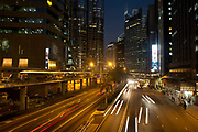 Connaught Street in Central Hong Kong with night time traffic shot at long exposure. 7 million people live on 1,104km square, making it Hong Kong the most vertical city in the world.