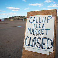 A sign at the Gallup Flea Market stating their closure Saturday, March 14 in Gallup. Vendors and families economically impacted by the closure are encouraged to call the New Mexico Family Support Services Coronavius Impact hotline at 1-833-551-0518 for assistance.