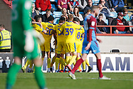 Goal celebration by Wimbledon forward James Hanson (18)  during the EFL Sky Bet League 1 match between Scunthorpe United and AFC Wimbledon at Glanford Park, Scunthorpe, England on 30 March 2019.