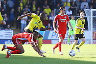 Burton Albion forward Marvin Sordell (17) and Scunthorpe United defender Cameron Borthwick-Jackson (3) during the EFL Sky Bet League 1 match between Burton Albion and Scunthorpe United at the Pirelli Stadium, Burton upon Trent, England on 29 September 2018.