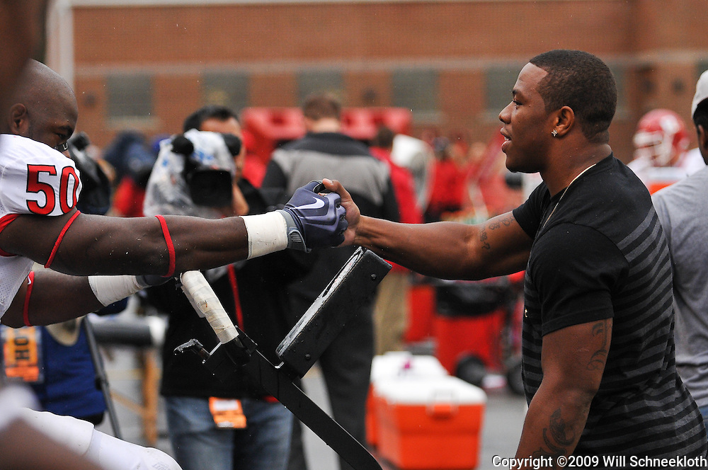 Sep 26, 2009; College Park, MD, USA; Rutgers linebacker Antonio Lowery (50) is greeted by Rutgers alumni and Baltimore Raven Ray Rice during the first half of Rutgers' 34-13 victory over Maryland in NCAA college football at Byrd Stadium.