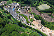 Aerial view of a riverside sand and gravel quarry on Kauai, Hawaii.