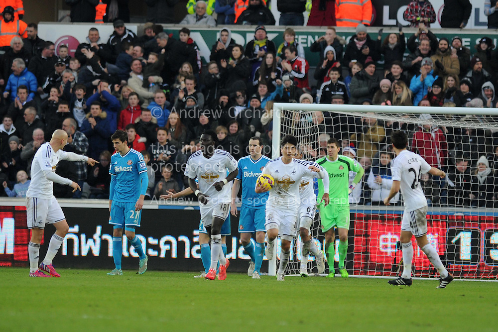 Ki Sung-Yueng of Swansea city © celebrates after he scores his teams 1st goal to make it 1-1. Barclays premier league match, Swansea city v Sunderland at the Liberty stadium in Swansea, South Wales on Saturday 7th Feb 2015.<br /> pic by Andrew Orchard, Andrew Orchard sports photography.
