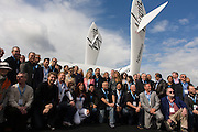 Signed up Virgin Galactic astronauts gather by SpaceShipTwo  model for another announcement by company executives at a PR event.
