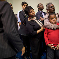 """SUMTER, SC - FEBRUARY 24:  Joe Bostick, 7, is embraced by his grandmother, Wilhelmenina Presley, while they wait in line to take their seats for a """"Breaking Down Barriers Town Hall"""" with Democratic Presidential candidate, former Secretary of State Hillary Clinton at Morris College February 24, 2016 in Sumter, ahead of the South Carolina Democratic Presidential Primary on February 27.  Last Saturday, the South Carolina GOP Presidential Primary shattered records with 137,092 more votes cast than in any previous primary.  (Photo by Mark Makela/Getty Images)"""