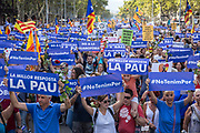 """A huge demonstration with half a million people gathered in Barcelona in a rally through Passeig de Gracia till Plaça de Catalunya, after the terrorists attacks in Las Ramblas and Cambrils on last august 17th. There were thousands of roses and placards claiming the peace under the catalan motto """"no tinc por"""", """"I'm not afraid"""".  There were also messages denouncing violence and condemning Spain for selling weapons. The muslim community joined shouting """"not in my name"""" and """"they are terrorists, not muslims"""" referring to the killers. Workers from health serviced and local police were honored by many people. The demonstration has been organized by the Catalan Government, with the King of Spain, the president of Spain and Catalonia.  Barcelona, 26th August. Photo: Eva Parey/4SEE"""