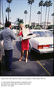 Lady with Gift. Beverly Hills. Los Angeles. 1989.Film.901132<br /><br />© Copyright Photograph by Dafydd Jones<br />66 Stockwell Park Rd. London SW9 0DA<br />Tel 0171 733 0108