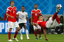 June 19, 2018 - Saint Petersburg, Russia - Ilya Kutepov (R) of the Russia national football team vie for the ball during the 2018 FIFA World Cup match, first stage - Group A between Russia and Egypt at Saint Petersburg Stadium on June 19, 2018 in St. Petersburg, Russia. (Credit Image: © Igor Russak/NurPhoto via ZUMA Press)