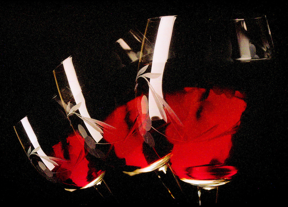 triple shot of wine glasses falling with red wine,color,horizontal