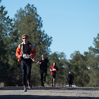 021415      Cayla Nimmo<br /> <br /> Nathan Whitfield runs the five mile section up Mount Taylor for the annual Quadrathalon in Grants Saturday.