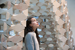 """© Licensed to London News Pictures. 15/09/2017. London, UK. A staff member stands in front of """"While We Wait"""" by Palestinian architects Elias and Yousef Anastas at the V&A museum in Kensington.  This work forms part of the London Design Festival, a programme of events and installations celebrating design taking place across the capital 16-24 September 2017.  Photo credit : Stephen Chung/LNP"""