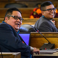 Navajo Nation council delegate Seth Damon and other delegates turn to wish a colleague a happy birthday during the Navajo Nation Council session Tuesday in Window Rock.