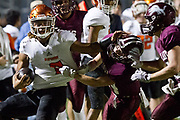 Bobcat QB Jaylon Mascorro pushes a Lovelady Lion defender as he runs towards the goal line during their <br /> Class 2A Division I semifinals game at Georgetown ISD Athletic Complex. Photo:Jaime R. Carrero/jcarrero@vicad.com