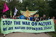 Extinction Rebellion climate activists enter Hyde Park at the end of a colourful March for Nature on the final day of their two-week Impossible Rebellion on 4th September 2021 in London, United Kingdom. Extinction Rebellion are calling on the UK government to cease all new fossil fuel investment with immediate effect.