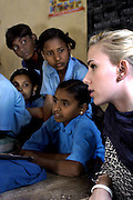 Scarlett Johansson joins a class with school children at an Oxfam funded rural Dalit school in Ghazipur district in the north Indian state of Uttar Pradesh. The school which was started in 2001 was set up to enable poor low caste Dalit children to gain an education in an area of India where the literacy rate stands at 19%.