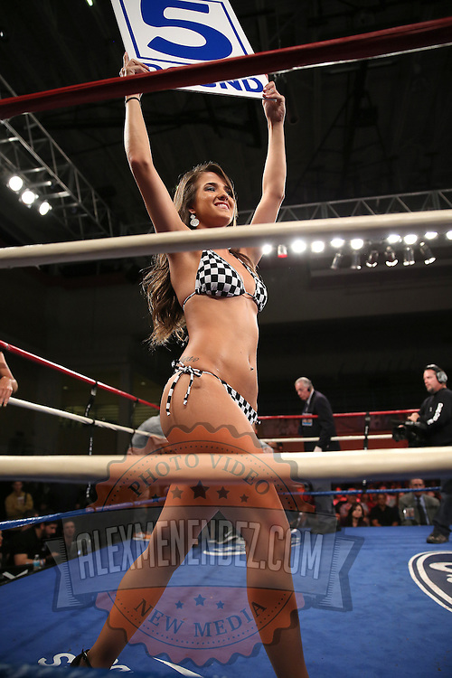 """A ring girl holds up the round card during the """"Boxeo Telemundo"""" boxing match at the Kissimmee Civic Center on Friday, March 14, 2014 in Kissimmme, Florida. (Photo/Alex Menendez)"""