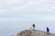 Liana (left) and Parmenter Welty approach a sculpture representing Saturn, part of Norwegian artist Jan Wanggaard's Planet Lofoten - a scaled model of the solar system - on Bunes Beach, Moskenesoya, Lofoten Islands, Norway.