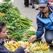 A customer buys a bunch of bananas at the morning market in Luang Prabang, Laos.