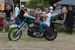 Paisley rides in the tour-pack of Timmy Marr's chopper-bagger during the Run to Raton. Raton, NM. USA. Saturday July 21, 2018. Photography ©2018 Michael Lichter.