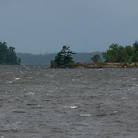 Whitecaps break between islands on Lake of the Woods, Ontario, Canada.