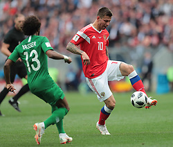June 14, 2018 - Moscow, U.S. - MOSCOW, RUSSIA - JUNE 14: Midfielder Fedor Smolov of Russia and defender Yasir Alshahrani of Saudi Arabia during a Group A 2018 FIFA World Cup soccer match between Russia and Saudi Arabia on June 14, 2018, at the Luzhniki Stadium in Moscow, Russia. (Photo by Anatoliy Medved/Icon Sportswire) (Credit Image: © Anatoliy Medved/Icon SMI via ZUMA Press)