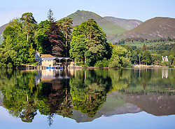 © Licensed to London News Pictures. 29/06/2018. Keswick UK. Derwent Isle reflects in to the calm water of Derwent water in Keswick, Cumbria this morning. Photo credit: Andrew McCaren/LNP