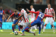 Jason Puncheon of Crystal Palace challenges Wilfried Bony of Stoke City. Premier League match, Crystal Palace v Stoke city at Selhurst Park in London on Sunday 18th Sept 2016. pic by John Patrick Fletcher, Andrew Orchard sports photography.