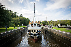 """© Licensed to London News Pictures. 30/09/2016. Bartington UK. Picture shows the Daniel Adamson making it's way through Dutton locks on the River Weaver on it's maiden voyage after a £5M renovation. The Daniel Adamson steam boat has been bought back to operational service after a £5M restoration. The coal fired steam tug is the last surviving steam powered tug built on the Mersey and is believed to be the oldest operational Mersey built ship in the world. The """"Danny"""" (originally named the Ralph Brocklebank) was built at Camel Laird ship yard in Birkenhead & launched in 1903. She worked the canal's & carried passengers across the Mersey & during WW1 had a stint working for the Royal Navy in Liverpool. The """"Danny"""" was refitted in the 30's in an art deco style. Withdrawn from service in 1984 by 2014 she was due for scrapping until Mersey tug skipper Dan Cross bought her for £1 and the campaign to save her was underway. Photo credit: Andrew McCaren/LNP"""