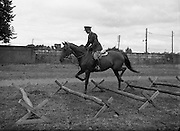 22/07/1952<br /> 07/22/1952<br /> 22 July 1952<br /> Army Equitation School, McKee Barracks, Cabra, Dublin. Captain Kevin Barry schooling an untrained horse.