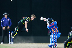 © Licensed to London News Pictures. 28/09/2012. Indian batsmen Suresh Raina hits Shane Watson for four runs during the T20 Cricket World cup match between Australia Vs India at the R.Premadasa Cricket Stadium,Colombo. Photo credit : Asanka Brendon Ratnayake/LNP
