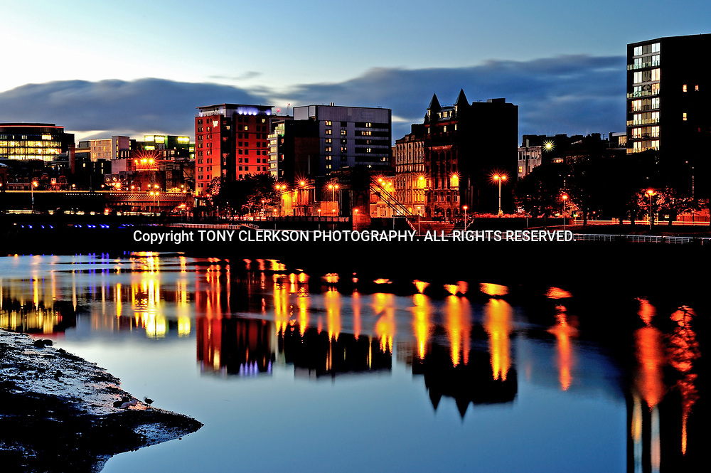 Calm, clear night over Glasgow's River Clyde as night falls.