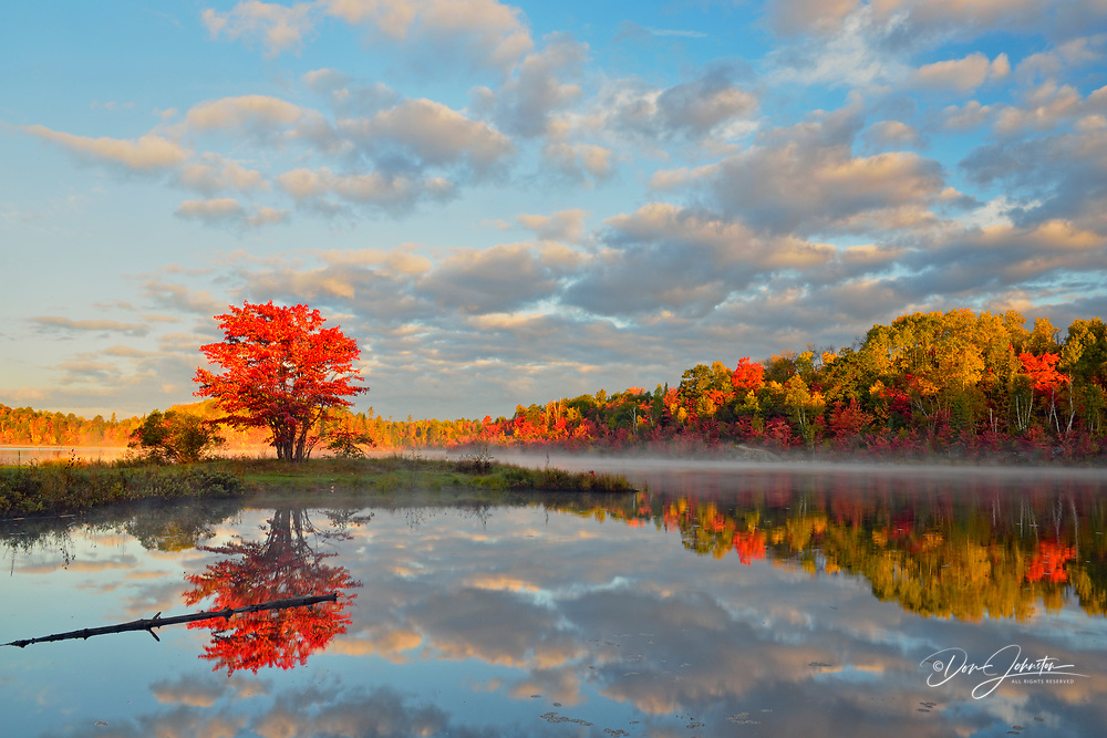 Autumn reflections in St. Pothier Lake, Greater Sudbury, Ontario, Canada