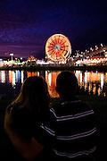 A couple enjoys the view of the South Carolina Coastal Fair in Charleston, SC.