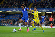 Willian of Chelsea holds off Avi Rikan of Maccabi Tel Aviv. UEFA Champions League group G match, Chelsea v Maccabi Tel Aviv at Stamford Bridge in London on Wednesday 16th September 2015.<br /> pic by John Patrick Fletcher, Andrew Orchard sports photography.