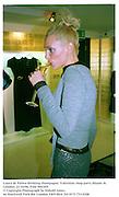Laura de Palma drinking champagne. Valentino shop party.Sloane St. London. 21/10/96. Film 96634f5<br />© Copyright Photograph by Dafydd Jones<br />66 Stockwell Park Rd. London SW9 0DA<br />Tel 0171 733 0108