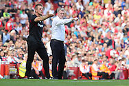 West Ham United manager David Moyes & assistant Stuart Pearce synchronise arm movements during the Premier League match between Arsenal and West Ham United at the Emirates Stadium, London, England on 22 April 2018. Picture by Bennett Dean.