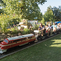 People ride on miniature train carriages at the Garden Railway Festival held in Hungarian Railway Mueum in Budapest, Hungary on Sept. 12, 2021. ATTILA VOLGYI