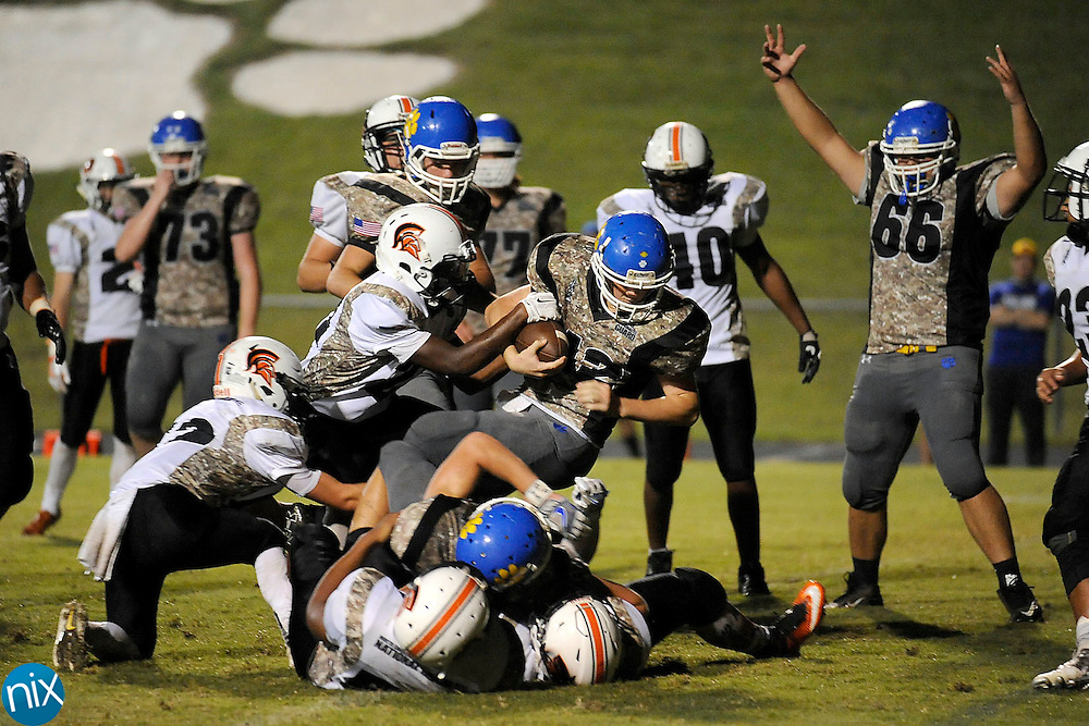 """Tigers offensive lineman  Nathan Barrier (66, right) signals """"Touchdown"""" as Tigers running back Landon Honeycutt (42) scores the 3rd touchdown during the Northwest Cabarrus Trojans at Mt. Pleasant Tigers high school football game Friday night."""