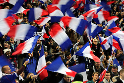 Fans wave flags in the stands prior to the match