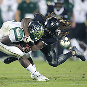 UCF Knights linebacker Shaquem Griffin (18) attempts to tackle South Florida Bulls quarterback Quinton Flowers (9) during a NCAA football game between the University of South Florida Bulls and the UCF Knights at Spectrum Stadium on Friday, November 24, 2017 in Orlando, Florida. (Alex Menendez via AP)
