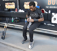 CHICAGO - AUGUST 24:  Tim Anderson #7 of the Chicago White Sox laces up his custom Adidas cleats in the dugout prior to the game against the Texas Rangers during Players Weekend on August 24, 2019 at Guaranteed Rate Field in Chicago, Illinois.  (Photo by Ron Vesely)  Subject:   Tim Anderson