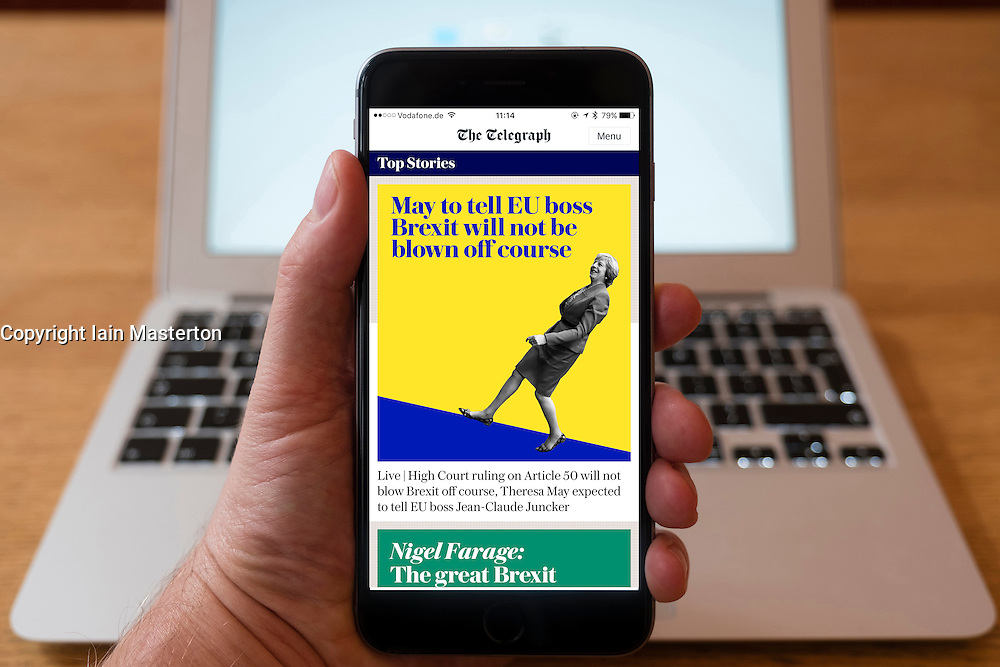 Using iPhone smartphone to display headlines on homepage of The Telegraph UK national newspaper mobile edition